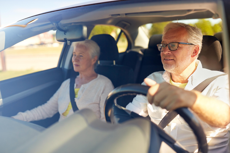 Cancer Survivor Driving Cancer Patient to Treatment